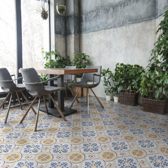 Interior shot of cafeteria with modern design and furniture decorated with plenty of green plants.